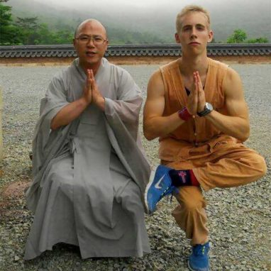 Monk and student in yoga pose