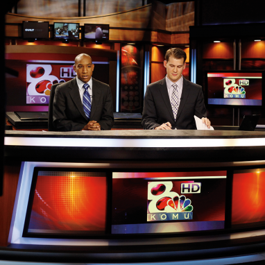 Two KOMU student anchors at the news desk