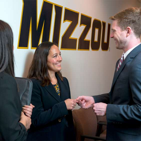 Job recruiter hands business card to student